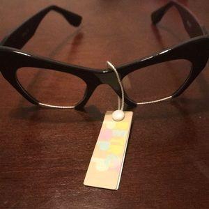 Cat eye,,clear glasses...black frames